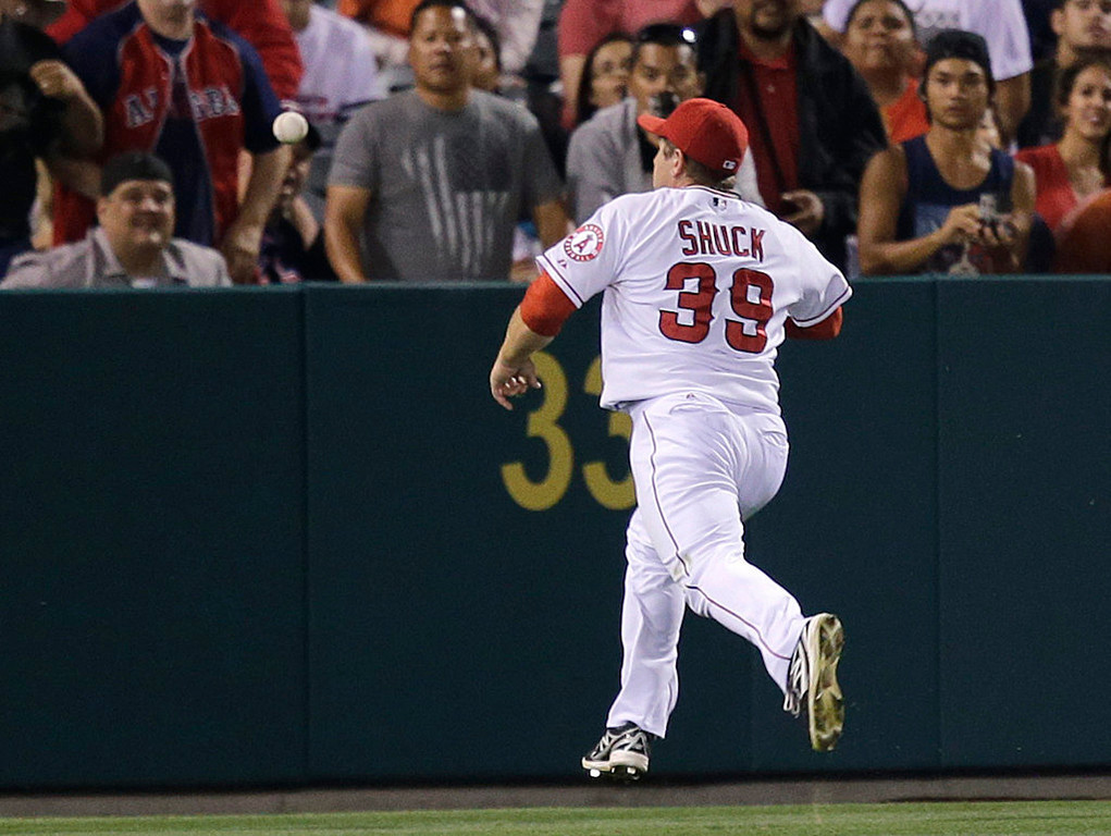 . Los Angeles Angels left fielder J.B. Shuck goes after a ball hit for double by Minnesota Twins\' Doug Bernier during the fourth inning of a baseball game on Monday, July 22, 2013, in Anaheim, Calif. (AP Photo/Jae C. Hong)