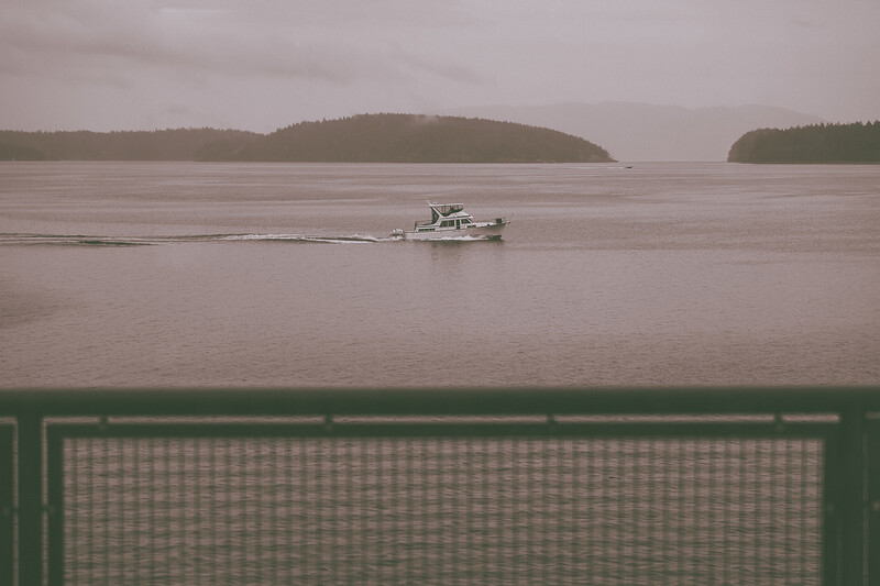 Two boats, one near and one far, race ahead of our ferry, enroute to Lopez Island.