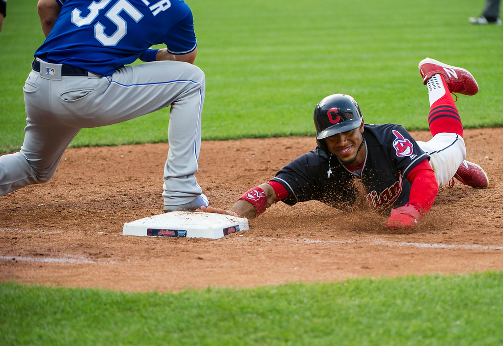 . Cleveland Indians\' Francisco Lindor dives safely back to first ahead of a tag by Kansas City Royals\' Eric Hosmer during the eighth inning of a baseball game in Cleveland, Saturday, Sept. 16, 2017. (AP Photo/Phil Long)