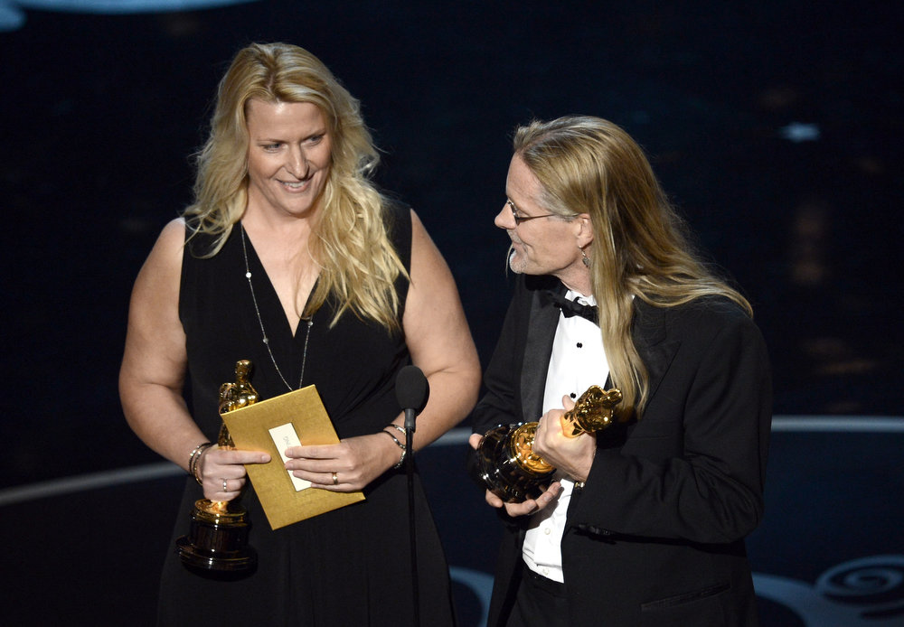 "Description of . Sound editors Karen Baker Landers and Per Hallberg accept the Best Sound Editing award for \'Skyfall"" onstage during the Oscars held at the Dolby Theatre on February 24, 2013 in Hollywood, California.  (Photo by Kevin Winter/Getty Images)"
