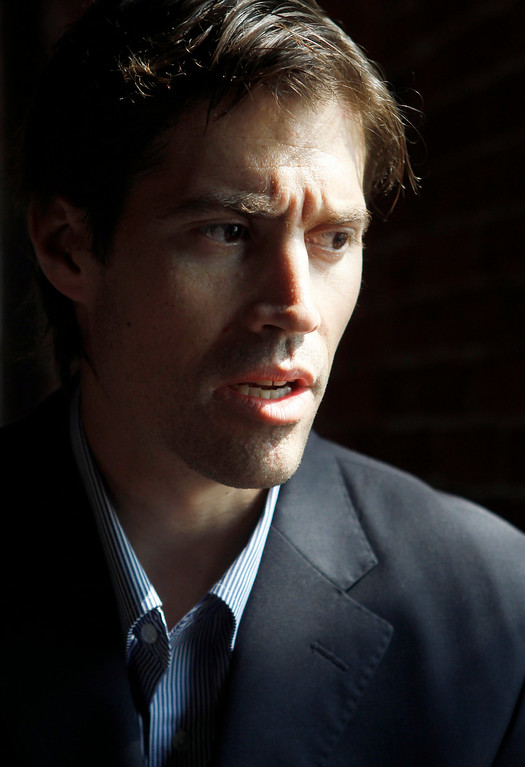 . Journalist James Foley, of Rochester, N.H., responds to questions during an interview with The Associated Press, in Boston, Friday, May 27, 2011. Foley, who was working for the Boston-based GlobalPost while reporting on the conflict in Libya, was captured along with two others by Libyan government forces on April 5, 2011. Foley, American freelance journalist Clare Morgana Gillis, of New Haven, Conn., and Spanish photographer Manu Brabo were released by Libyan authorities last week. (AP Photo/Steven Senne)
