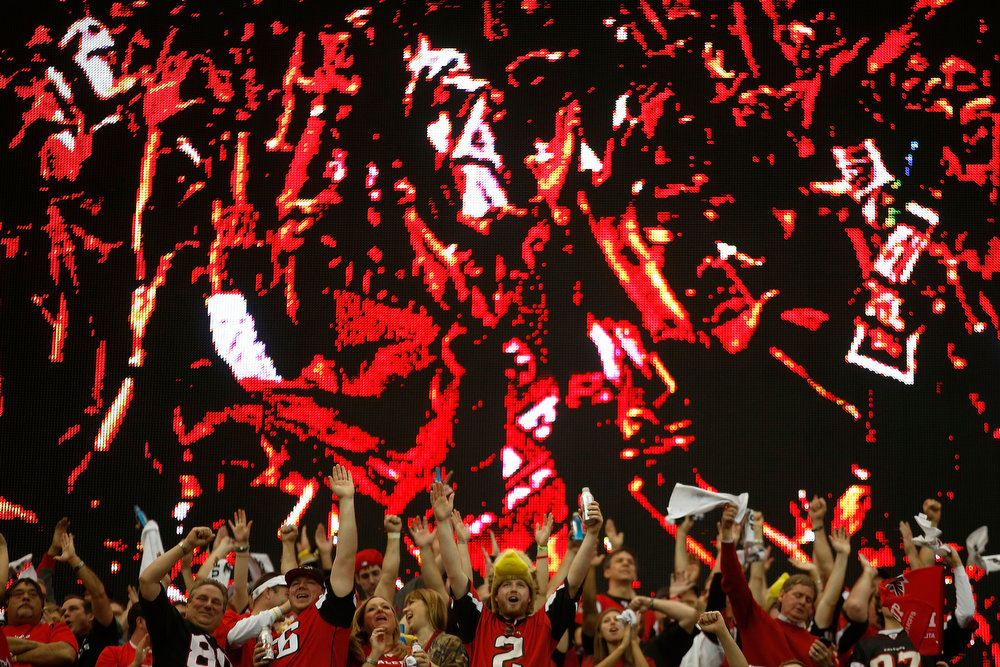 Description of . Atlanta Falcons fans cheer in the second quarter as the Falcons take on the San Francisco 49ers in the NFC Championship game at the Georgia Dome on January 20, 2013 in Atlanta, Georgia.  (Photo by Chris Graythen/Getty Images)