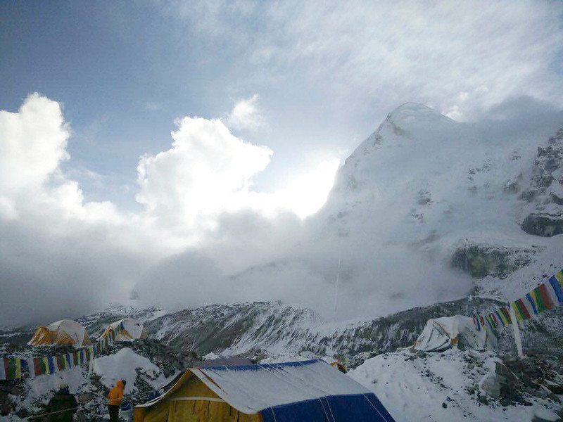 . This photo provided by Azim Afif, shows a small avalanche on Pumori mountain as seen from Everest Base Camp, Nepal on Sunday, April 26, 2015. On Saturday, a large avalanche triggered by Nepal\'s massive earthquake slammed into a section of the Mount Everest mountaineering base camp, killing a number of people and left others unaccounted for. Afif and his team of four others from the Universiti Teknologi Malaysia (UTM) all survived the avalanche. (Azim Afif via AP)
