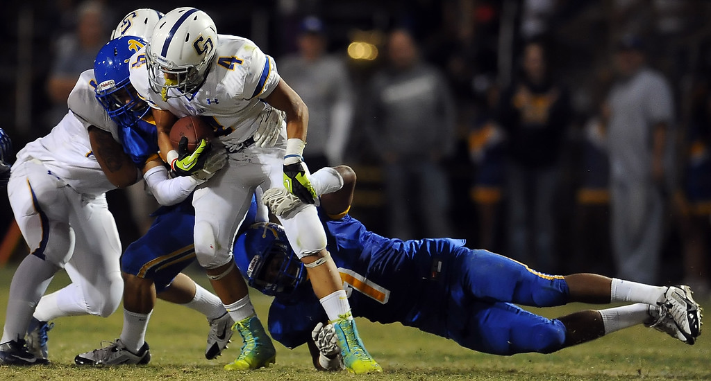. Bishop Amat\'s Nicholas Bohorquez (7) tackles Charter Oak\'s Donavin Washington (4) in the first half of a prep football game at Bishop Amat High School in La Puente, Calif. on Friday, Sept. 20, 2013.    (Photo by Keith Birmingham/Pasadena Star-News)