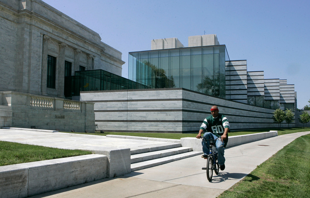 . A bicyclist rides past the east wing galleries at the Cleveland Museum of Art in Cleveland in 2009. The Cleveland institution marked its centennial anniversary in 2016. (AP Photo/Tony Dejak)