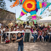 Children hit piñata at party celebrating the addition of running water to houses in the village.