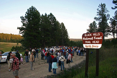 """The Moon Walks were created to provide a """"family-oriented activity that introduces visitors to the cultural and natural history of the Black Hills.""""  The walks are held on the Saturday night close to the official full moon and begin at 7:00 p.m.  Typically, the walks last one to two hours.  The gathering point this time was at the North Shore Trail Head at Deerfield Reservoir.  A reminder that you can click on any photograph in order to see a larger image.  Perhaps you'll see someone you recognize!"""