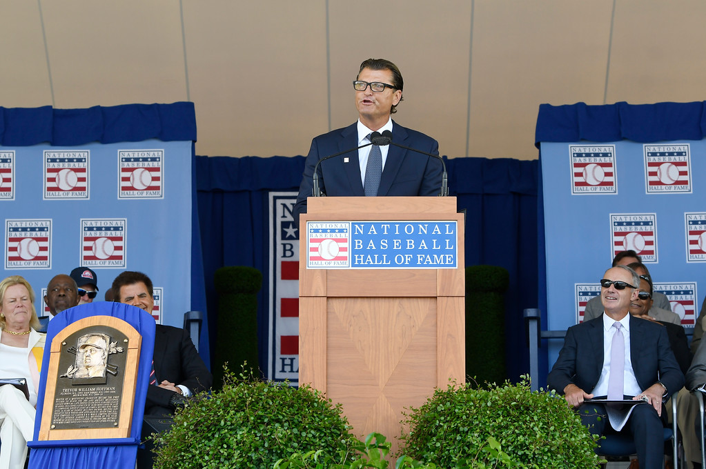 . National Baseball Hall of Fame inductee Trevor Hoffman, center, speaks during an induction ceremony at the Clark Sports Center on Sunday, July 29, 2018, in Cooperstown, N.Y. (AP Photo/Hans Pennink)