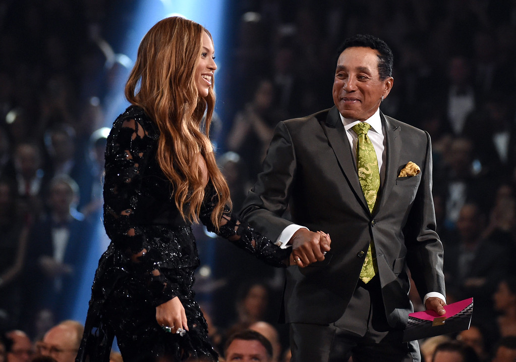 . Smokey Robinson, right, presents Beyonce with the award for best R&B performance for �Drunk in Love� at the 57th annual Grammy Awards on Sunday, Feb. 8, 2015, in Los Angeles. (Photo by John Shearer/Invision/AP)