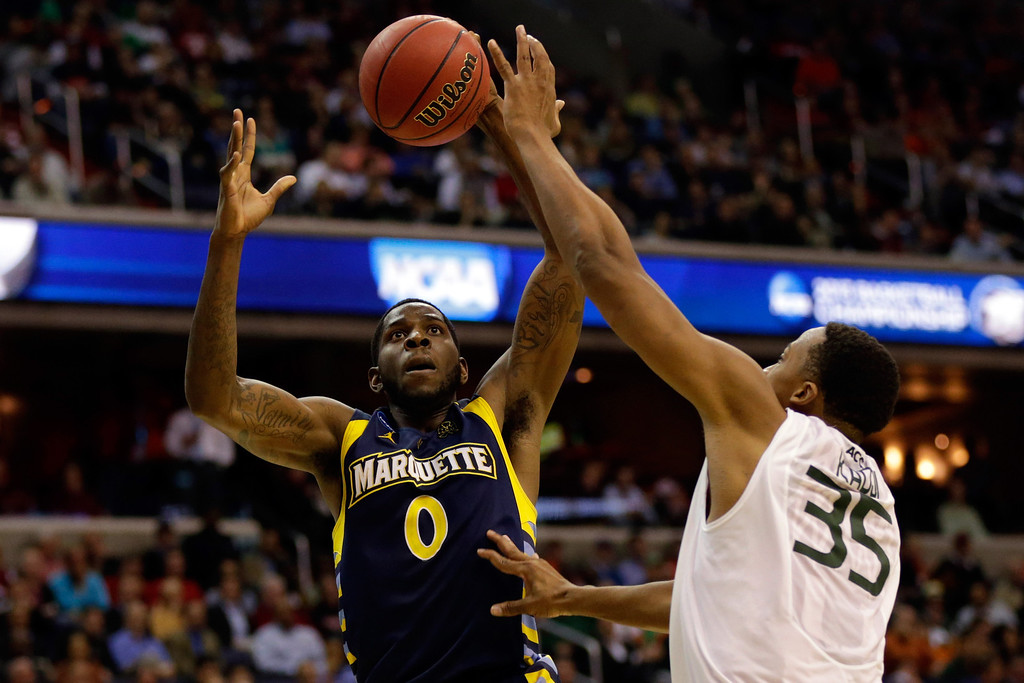 . WASHINGTON, DC - MARCH 28:  Jamil Wilson #0 of the Marquette Golden Eagles loses the ball while going to the hoop against Kenny Kadji #35 of the Miami (Fl) Hurricanes during the East Regional Round of the 2013 NCAA Men\'s Basketball Tournament at Verizon Center on March 28, 2013 in Washington, DC.  (Photo by Win McNamee/Getty Images)