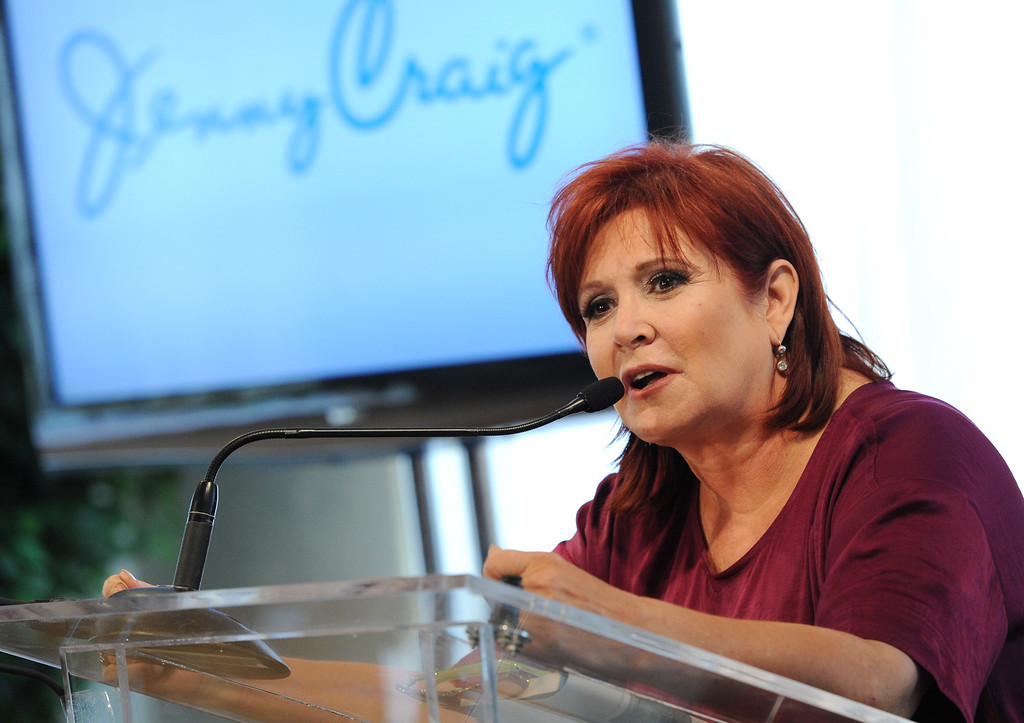 . Actress and author Carrie Fisher speaks to the media about being named new celebrity spokesperson for the Jenny Craig weight loss program on Wednesday, Jan. 12, 2011 in New York. (AP Photo/Evan Agostini)