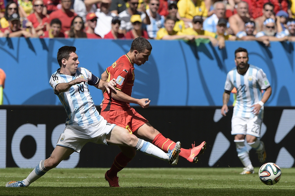 . Belgium\'s forward Eden Hazard (C) vies with Argentina\'s forward and captain Lionel Messi (L) during a quarter-final football match between Argentina and Belgium at the Mane Garrincha National Stadium in Brasilia during the 2014 FIFA World Cup on July 5, 2014. (JUAN MABROMATA/AFP/Getty Images)
