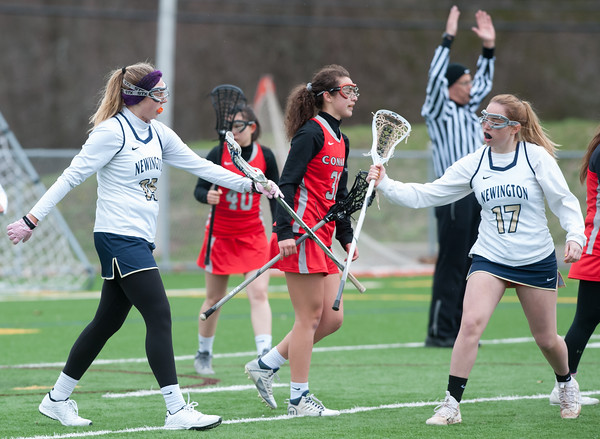 04/17/18 Wesley Bunnell | Staff Newington girls lacrosse was defeated 19-2 by Conard at Newington on Tuesday afternoon. Maya Gajowiak (19) is congratulated by Gabby Gray (17).