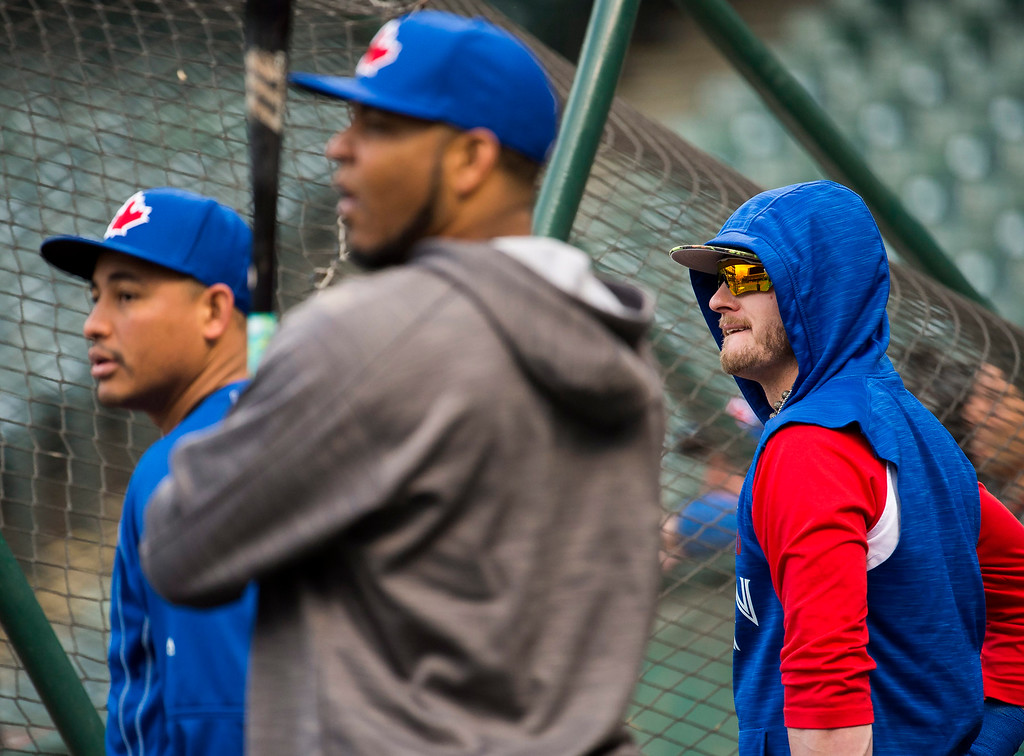 . Toronto Blue Jays third baseman Josh Donaldson, right, and teammates Edwin Encarnacion, center, and Ezequiel Carrera watch batting practice Thursday, Oct. 13, 2016, in Cleveland. The Blue Jays are scheduled to face the Cleveland Indians in Game 1 of baseball\'s American League Championship Series on Friday. (Nathan Denette/The Canadian Press via AP)