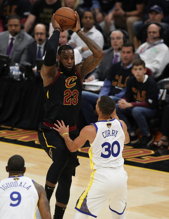 . Cleveland Cavaliers\' LeBron James is defended by Golden State Warriors\' Stephen Curry in the first half of Game 3 of basketball\'s NBA Finals, Wednesday, June 6, 2018, in Cleveland. (AP Photo/Carlos Osorio)