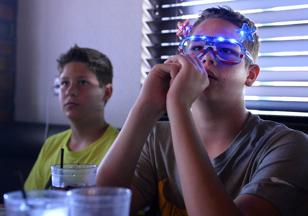 . Bradley Godwin, 14, right, of Redlands, watches the USA vs Belgium world cup game during a viewing party on Tuesday, July 1, 2014 at Darby\'s American Cantina in Redlands, Ca. (Photo by Micah Escamilla/The Sun)