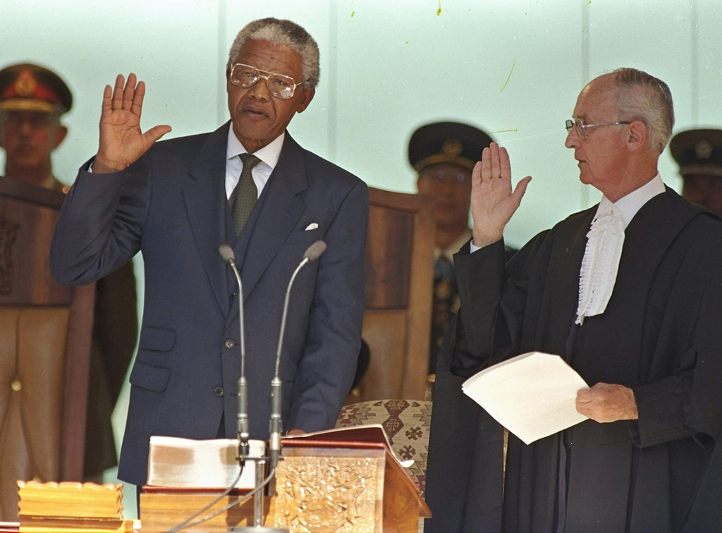 . In this May 10, 1994, file photo, Nelson Mandela, left, takes the oath of office in Pretoria, South Africa, to become the country\'s first black President. South Africa\'s President Jacob Zuma said, Thursday, Dec. 5, 2013, that Mandela has died. He was 95. (AP Photo/David Brauchli, File)