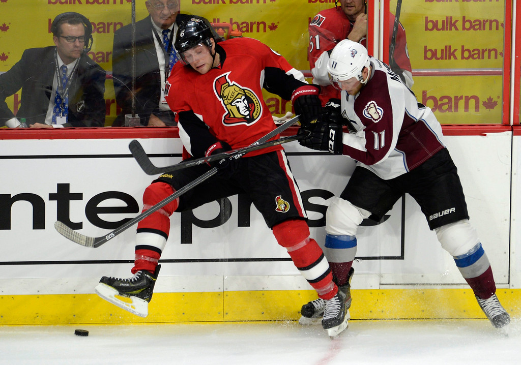 . Ottawa Senators\' Bobby Ryan (6) clashes with Colorado Avalanche\'s Jamie McGinn (11) during the third period of an NHL hockey game Thursday, Oct. 16, 2014, in Ottawa, Ontario. The Senators won 5-3. (AP Photo/The Canadian Press, Justin Tang)