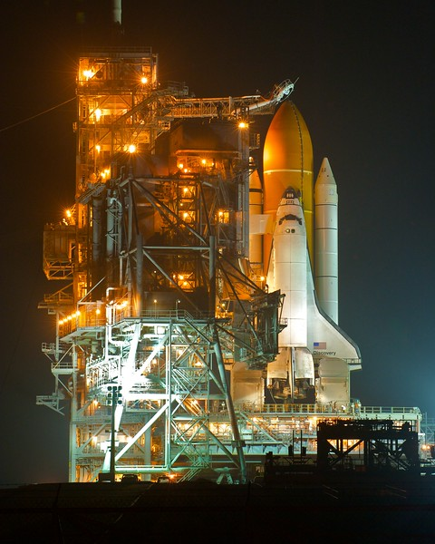 02/23/2011 -- Cape Canaveral, Florida -- The rotating service structure (RSS) continues the rollback from the space shuttle Discovery at Kennedy Space Center's Launch Pad 39A. The structure provides protection for and access to space shuttles while they are stationed at the launch pad.
