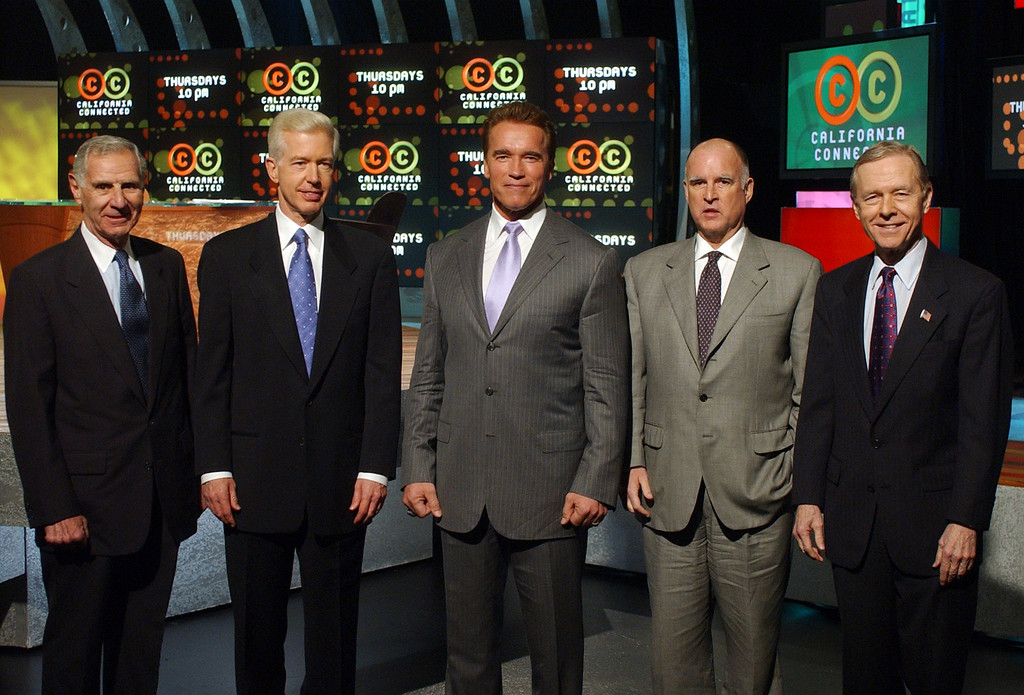 ". Former California Governors George Deukmejian, far left, Gray Davis, second from left, Jerry Brown, second from right, and Pete Wilson, far right, join current Governor Arnold Schwarzenegger, center, in a group photo prior to taping a forum on ""California Connected,\"" Tuesday, Feb. 17, 2004, in Los Angeles.  The show featured a panel discussion on \""Can California Be Governed\"" with the four former governors and a one-on-one interview with the new governor. (AP Photo/Rene Macura)"
