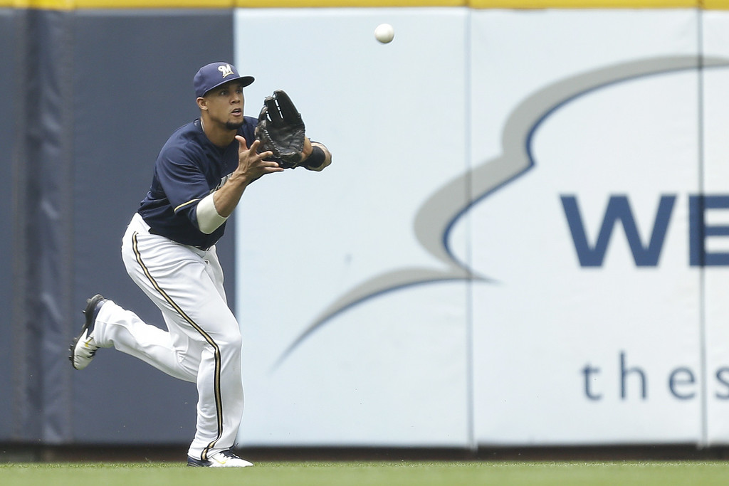 . MILWAUKEE, WI - JUNE 28: Carlos Gomez #27 of the Milwaukee Brewers makes the catch in centerfield to retire Troy Tulowitzki of the Colorado Rockies during the top of the first inning at Miller Park on June 28, 2014 in Milwaukee, Wisconsin. (Photo by Mike McGinnis/Getty Images)