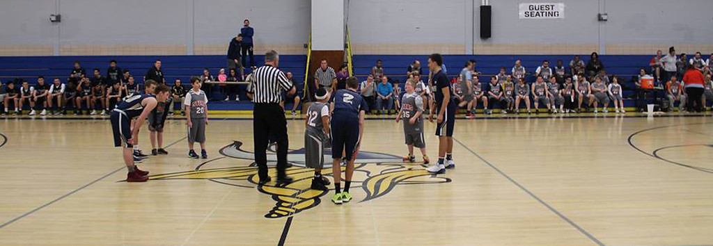 . PIAA basketball officials from the Norristown Chapter of the PIAA volunteered their services, and here they�re seen administering a jump ball to start the game. (Photo courtesy of Dan Gemmill)