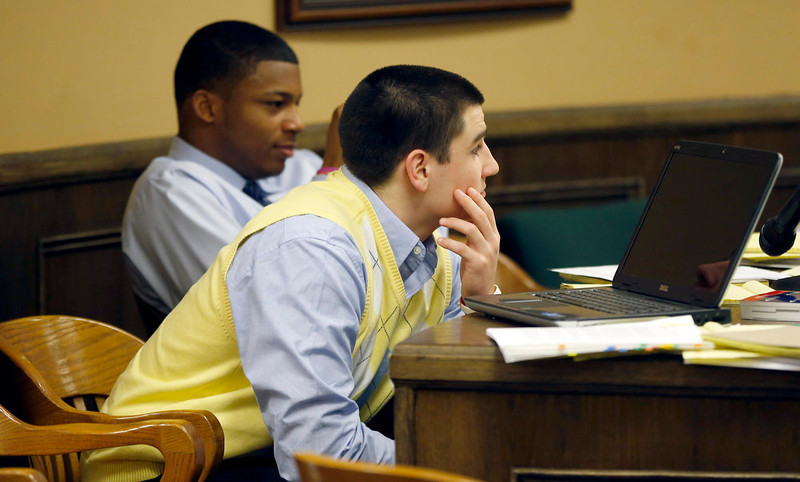 . Trent Mays, 17, left, and co-defendant 16-year-old Ma\'lik Richmond sit at the defense table during a recess of their trial on rape charges in juvenile court on Thursday, March 14, 2013, in Steubenville, Ohio. Mays and Richmond are accused of raping a 16-year-old West Virginia girl in August of 2012. (AP Photo/Keith Srakocic, Pool)