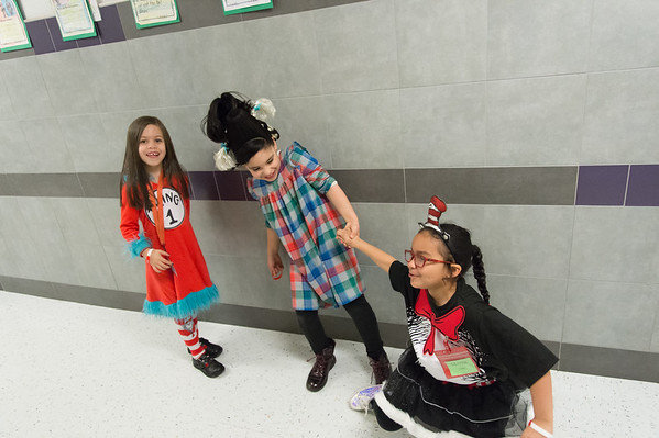 03/01/19 Wesley Bunnell | Staff Arianna Garcia looks on as Camila Arango helps Lilyana Correa off of the floor outside of their classroom at Gaffney Elementary School. The trio dressed as characters from Dr. Seuss books on Friday March 1st in observance of Read Across America Day and Dr. Seuss's birthday which is annually celebrated on March 2nd.