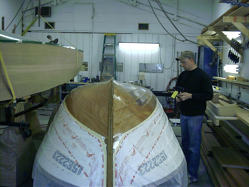 Starboard front view of third coat of epoxy being applied.