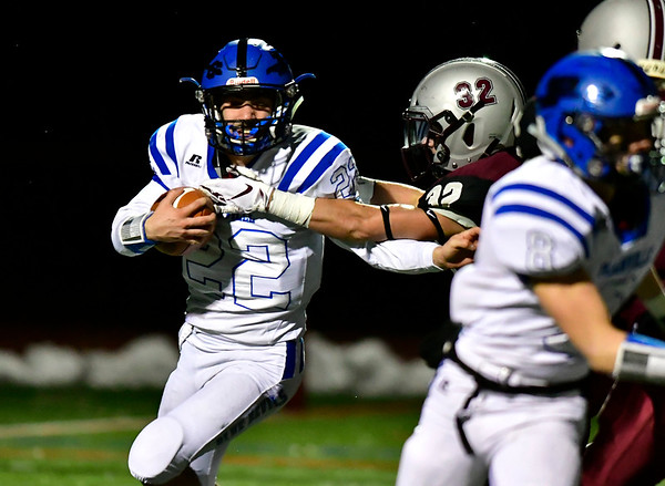 11/211/21/2018 Mike Orazzi | Staff Plainville's Brady Callahan (22) and Farmington's Finn Sposato (32) during Wednesday night's football game at Farmington High School.