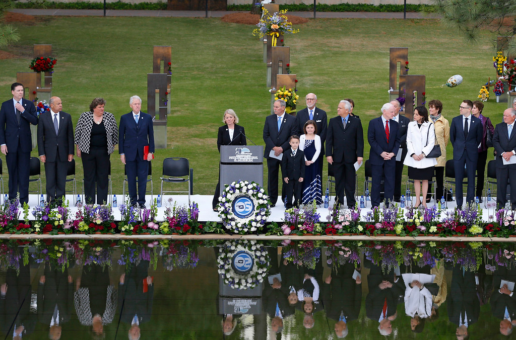 . Speakers, including former President Bill Clinton, fourth from left, stand at the opening of ceremonies to commemorate the 20th anniversary of the Oklahoma City bombing, at the Oklahoma City National Memorial, in Oklahoma City, Sunday, April 19, 2015. (AP Photo/Sue Ogrocki)