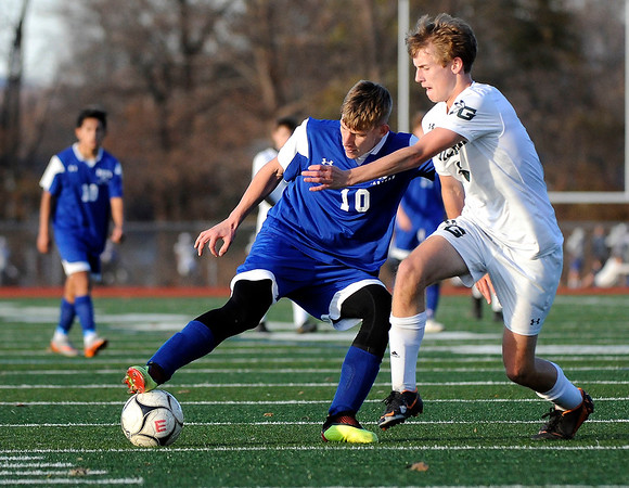 11/15/2019 Mike Orazzi | Staff Bristol Eastern's Jacob Woznicki (10) and Guilford's Cade Yerkes (2) during the Class L Quarterfinal State Boys Soccer Tournament at Eastern on Friday.