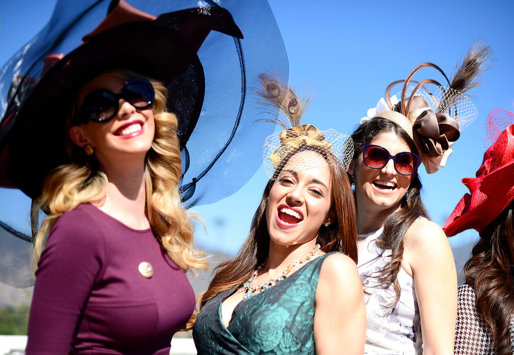 . Fashion bloggers from left, Kier Mellour, Elizabeth Keene and Laura Yazdi gather during the Breeders\' Cup at Santa Anita Park in Arcadia Friday, November 1, 2013. (Photo by Sarah Reingewirtz/Pasadena Star-News)