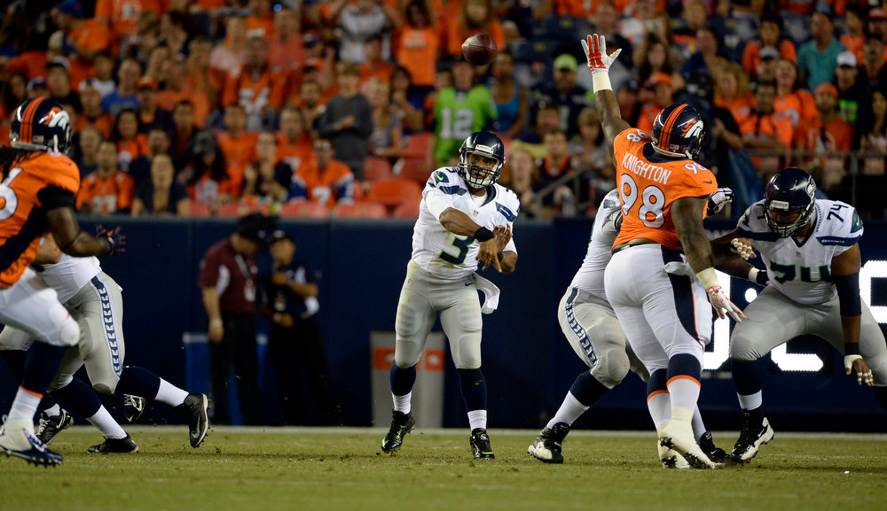 . Quarterback Russell Wilson (3) of the Seattle Seahawks throws the ball to wide receiver Doug Baldwin (89) of the Seattle Seahawks during the first half of the game.  The Denver Broncos vs the Seattle Seahawks At Sports Authority Field at Mile High. (Photo by AAron Ontiveroz/The Denver Post)