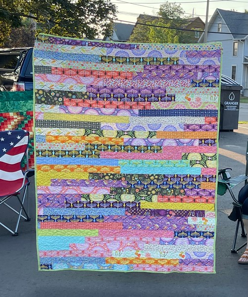 A jelly roll race quilt by Kelly Sattler.