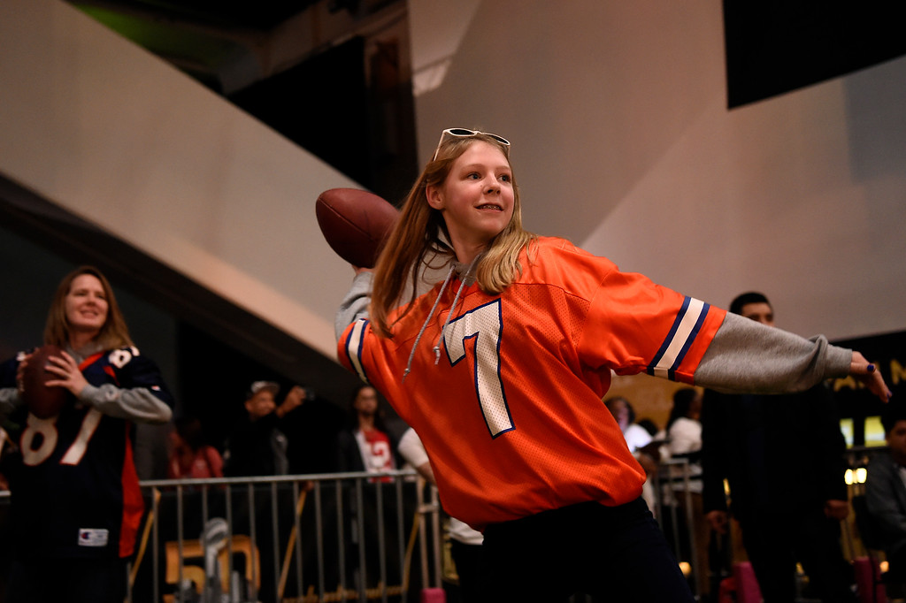 . SAN FRANCISCO, CA - FEBRUARY 05: 13 year old Hannah Kosmicki smiles all the way through her throw in the Critical Catch game as her mother Tina gets ready for her chance to hit receivers down field at the NFL Experience in downtown San Francisco, CA. February 05, 2016 (Photo by Joe Amon/The Denver Post)