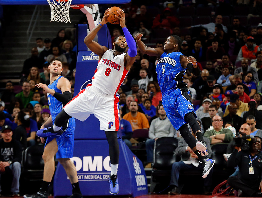 . Detroit Pistons center Andre Drummond (0) grabs a rebound from Orlando Magic guard Victor Oladipo (5) in the second half of an NBA basketball game in Auburn Hills, Mich., Wednesday, Jan. 21, 2015. (AP Photo/Paul Sancya)