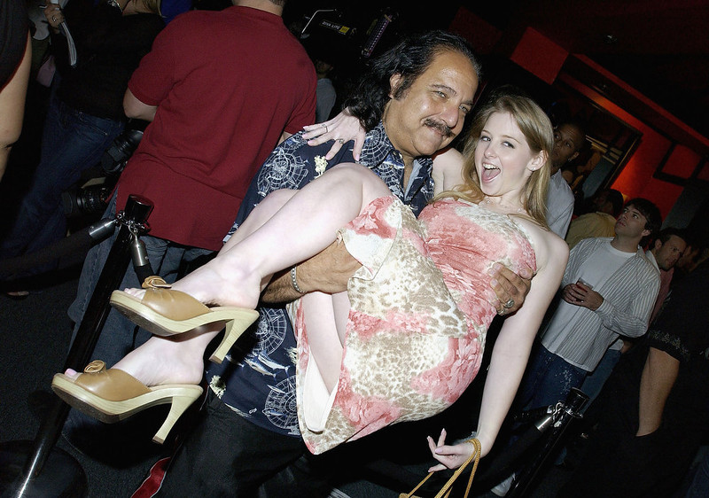 ". Porn and Reality TV star Ron Jeremy and his friend Sunny Lane attend the ""Kill Reality\"" premiere party at Saffire on July 25, 2005 in Hermosa Beach, California.   (Photo by Amanda Edwards/Getty Images)"
