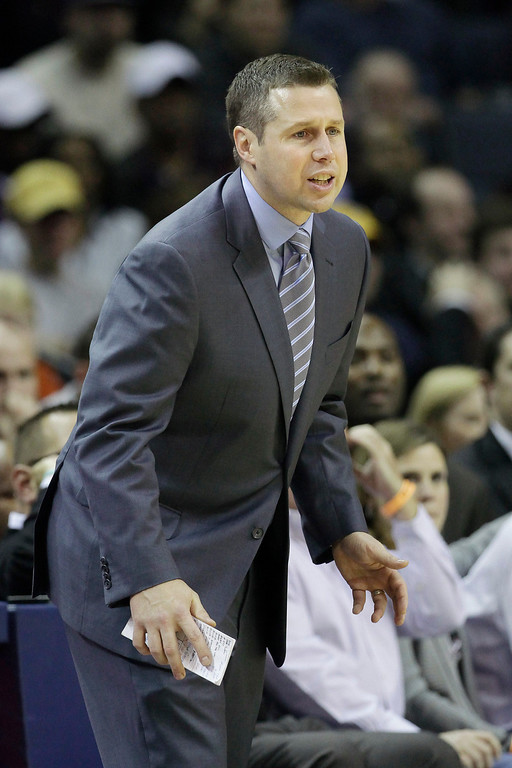. Memphis Grizzlies coach David Joerger watches the second half of an NBA basketball game against the Los Angeles Lakers in Memphis, Tenn., Tuesday, Dec. 17, 2013. The Lakers defeated the Grizzlies 96-92. (AP Photo/Danny Johnston)