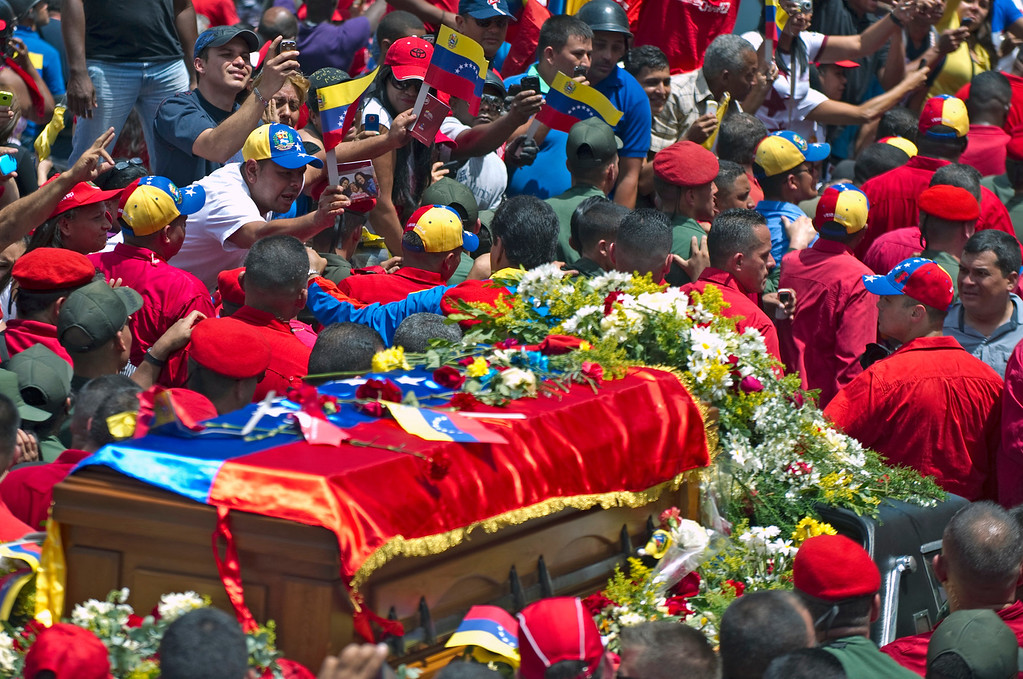 . The hearse carrying the coffin of Venezuelan President Hugo Chavez makes its way to the Military Academy amid thousands of supporters, on March 6, 2013, in Caracas.  AFP PHOTO/Juan BARRETO/AFP/Getty Images