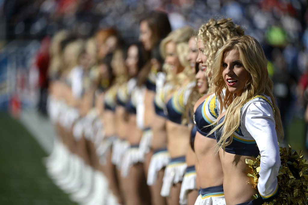 . The San Diego Chargers cheerleaders look onto the field before a game against the Kansas City Chiefs on December 29, 2013 at Qualcomm Stadium in San Diego, California. (Photo by Donald Miralle/Getty Images)