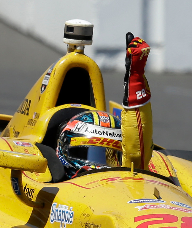 . Ryan Hunter-Reay celebrates after winning the Indianapolis 500 IndyCar auto race at the Indianapolis Motor Speedway in Indianapolis, Sunday, May 25, 2014. (AP Photo/Darron Cummings)