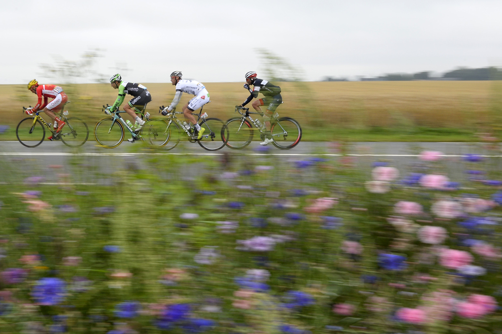 . (From L) Spain\'s Luis Angel Mate Mardones, Netherland\'s Thomas Leezer, France\'s Arnaud Gerard and France\'s Jerome Pineau ride in a breakaway during the 194 km sixth stage of the 101st edition of the Tour de France cycling race on July 10, 2014 between Arras and Reims, northern France.  (ERIC FEFERBERG/AFP/Getty Images)