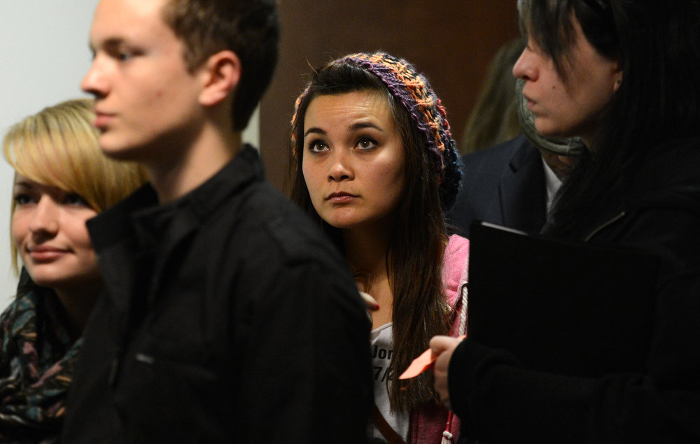 . Chantel Blunk, center, wife of Jonathan Blunk arrive for court, Monday, January 7, 2013, in Centennial. RJ Sangosti, The Denver Post
