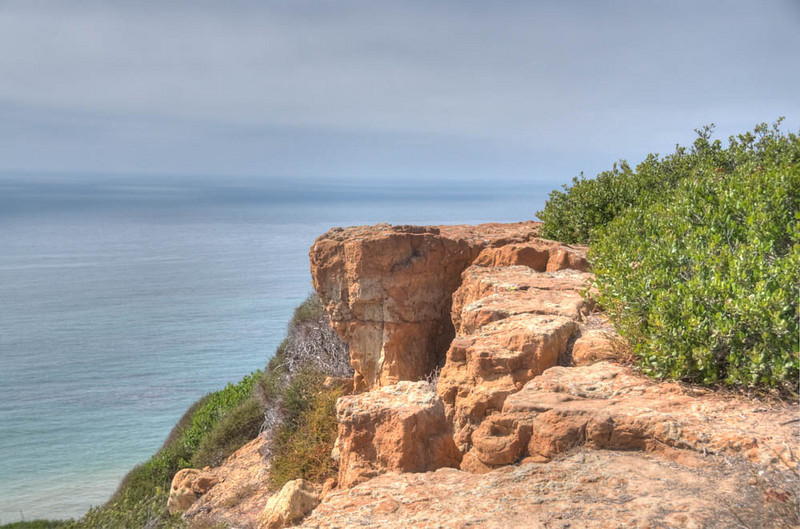 Tonemapped view of cliffs and Pacific ocean at Cabrillo National Monument in San Diego.
