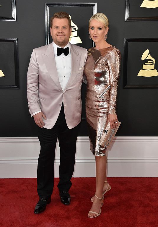 . James Corden, left, and Julia Carey arrive at the 59th annual Grammy Awards at the Staples Center on Sunday, Feb. 12, 2017, in Los Angeles. (Photo by Jordan Strauss/Invision/AP)
