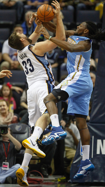 . Memphis Grizzlies center Marc Gasol (33) of Spain, gets tangled with Denver Nuggets forward Kenneth Faried in the first half of an NBA basketball game Friday, April 4, 2014, in Memphis, Tenn. (AP Photo/Lance Murphey)