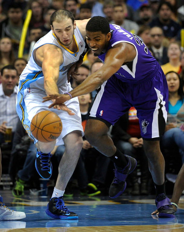 . Kosta Koufos (41) of the Denver Nuggets competes for a loose ball with Cole Aldrich (45) of the Sacramento Kings in the second half on March 23, 2013 at the Pepsi Center.  (Photo By Karl Gehring/The Denver Post)
