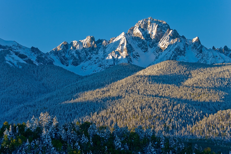Snowy sunrise on Mount Sneffels. Viewed from County Road 5 outside Ridgway, Colorado.