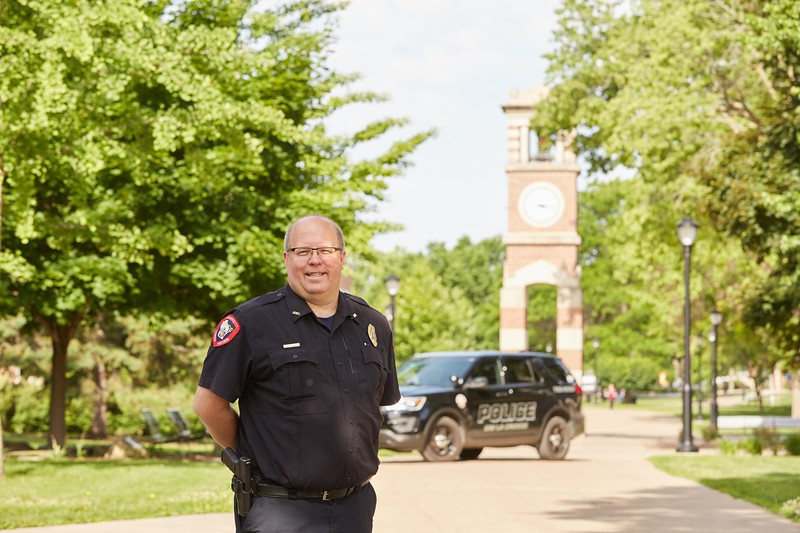Activity; Smiling; Type of Photography; Portrait; Buildings; Clock Hoeschler Tower; Location; Outside; People; Man Men; Time/Weather; day; Summer; June; UWL UW-L UW-La Crosse University of Wisconsin-La Crosse; Police Chief Scott McCullough